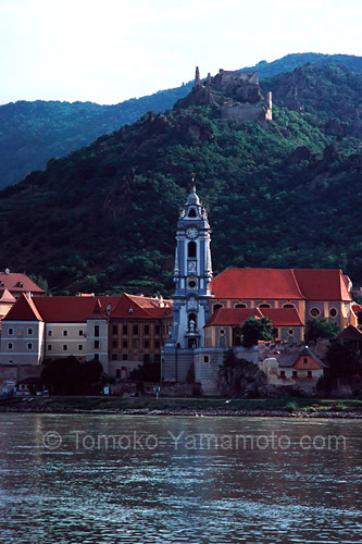 Castle Ruins are on a rocky outcrip above the Church Tower of an Augstinian monastery at Dürnstein: photo of Dürnstein at the Danube, Austria by Tomoko Yamamoto