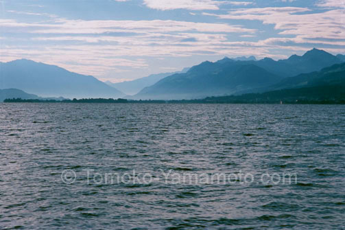 An early morning view of Mountains in Mist at Lake Zurich, Switzerland: photo of Lake Zurich, Switzerland by Tomoko Yamamoto